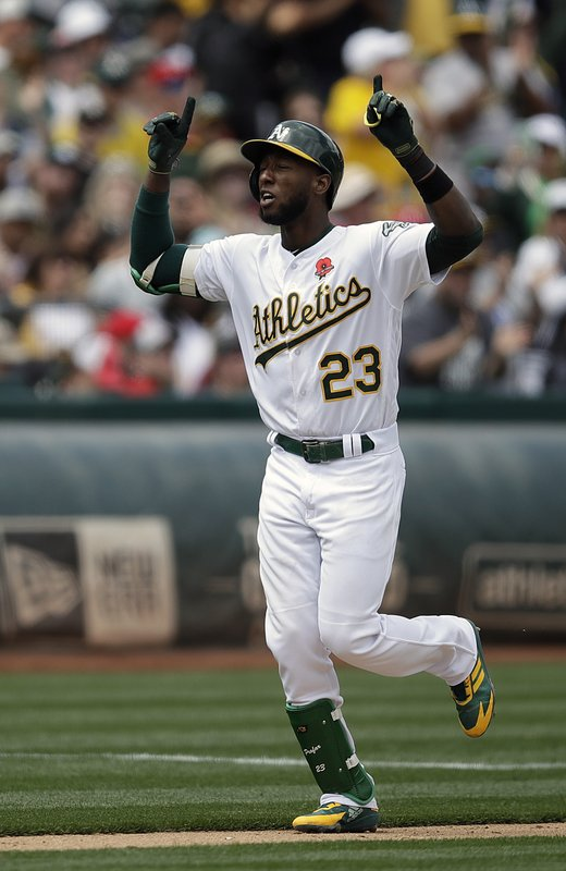 Oakland Athletics' Jurickson Profar celebrates after hitting a two-run home run off Los Angeles Angels' Trevor Cahill in the fourth inning of a baseball game Monday, May 27, 2019, in Oakland, Calif. (AP Photo/Ben Margot)