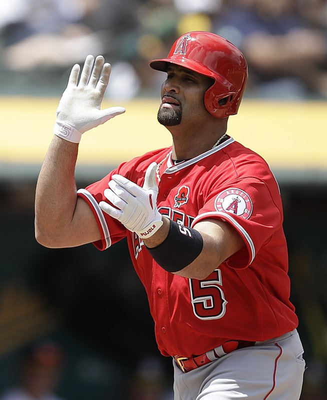 Los Angeles Angels' Albert Pujols celebrates after hitting a home run off Oakland Athletics' Chris Bassitt in the fourth inning of a baseball game Monday, May 27, 2019, in Oakland, Calif. (AP Photo/Ben Margot)