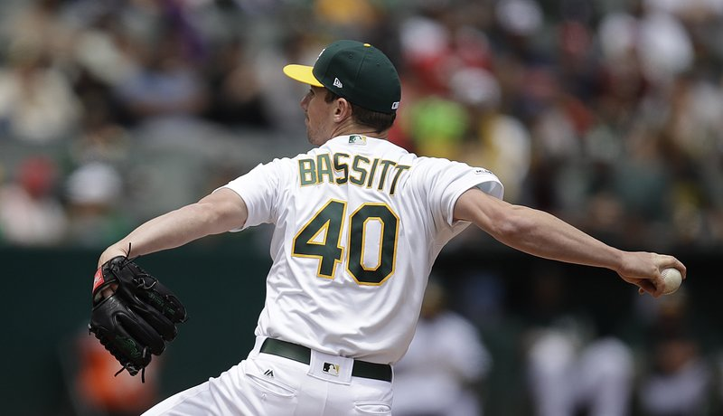 Oakland Athletics pitcher Chris Bassitt works against the Los Angeles Angels in the first inning of a baseball game Monday, May 27, 2019, in Oakland, Calif. (AP Photo/Ben Margot)