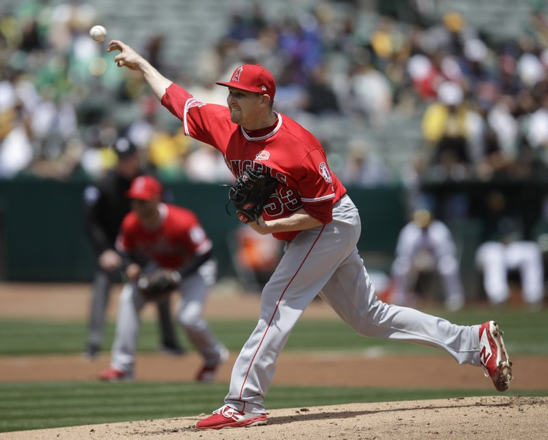Los Angeles Angels pitcher Trevor Cahill works against the Oakland Athletics in the first inning of a baseball game Monday, May 27, 2019, in Oakland, Calif. (AP Photo/Ben Margot)