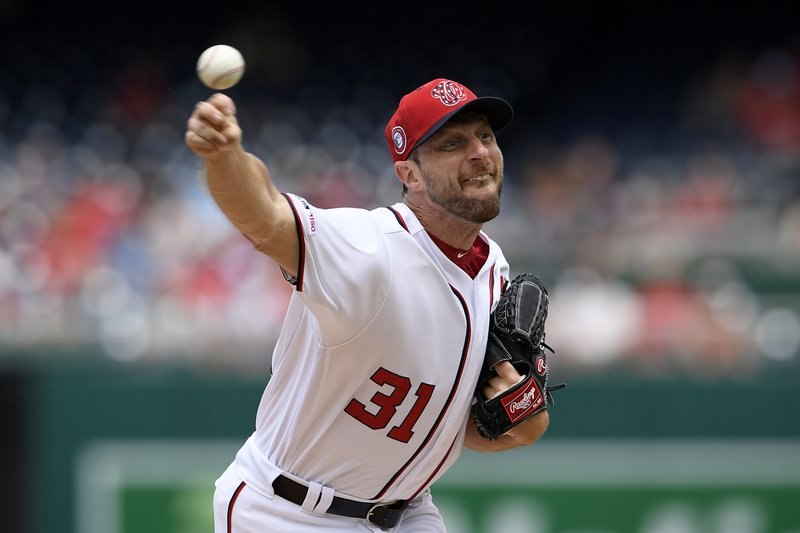 Washington Nationals starting pitcher Max Scherzer delivers during the fourth inning of a baseball game against the Miami Marlins, Monday, May 27, 2019, in Washington. (AP Photo/Nick Wass)