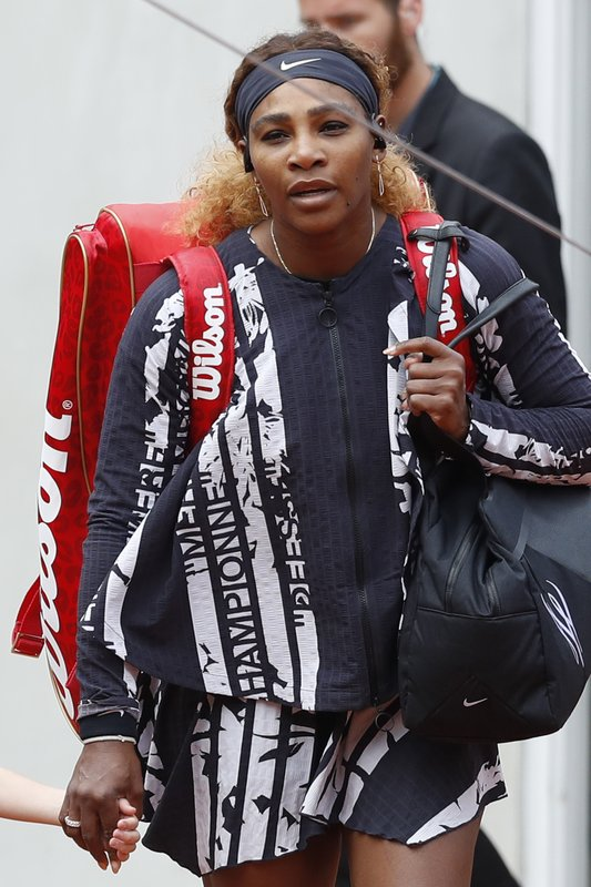 Serena Williams of the U.S. wears a jacket with French text reading