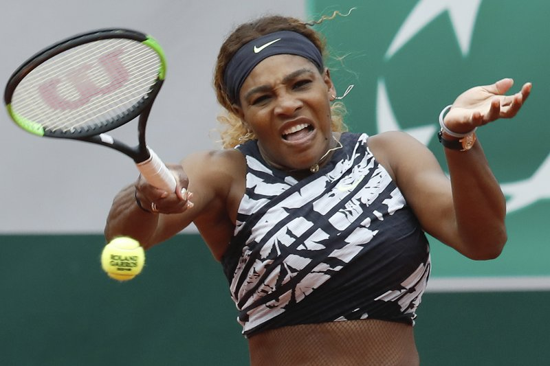Serena Williams of the U.S. plays a shot against Vitalia Diatchenko of Russia during their first round match of the French Open tennis tournament at the Roland Garros stadium in Paris, Monday, May 27, 2019. (AP Photo/Pavel Golovkin)