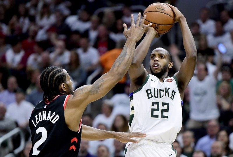 Toronto Raptors forward Kawhi Leonard (2) tries to block a shot from Milwaukee Bucks forward Khris Middleton (22) during the first half in Game 1 of the NBA basketball playoffs Eastern Conference final in Milwaukee on Wednesday, May 15, 2019. (Frank Gunn/The Canadian Press via AP)