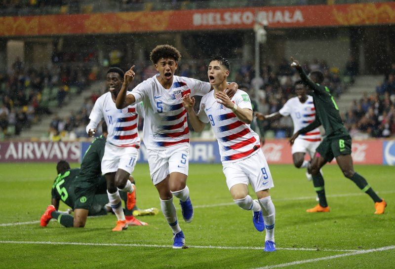 United States' Sebastian Soto, front right, celebrates with United States' Chris Richards after scores a disallowed goal during the Group D U20 World Cup soccer match between USA and Nigeria, in Bielsko Biala, Poland, Monday, May 27, 2019. (AP Photo/Sergei Grits)