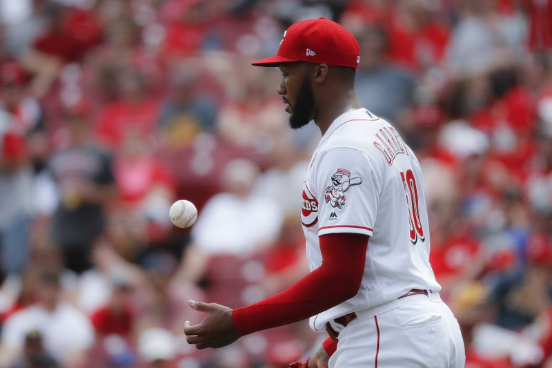 CORRECTS CITY TO CINCINNATI NOT COLUMBUS - Cincinnati Reds relief pitcher Amir Garrett reacts after giving up a solo home run to Pittsburgh Pirates' Josh Bell in the seventh inning during the first baseball game of a doubleheader, Monday, May 27, 2019, in Cincinnati. (AP Photo/John Minchillo)