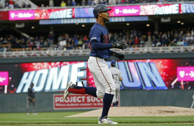 Minnesota Twins' Byron Buxton jogs home on a three-run home run off Milwaukee Brewers' Gio Gonzalez in the second inning of a baseball game Monday, May 27, 2019, in Minneapolis. (AP Photo/Jim Mone)