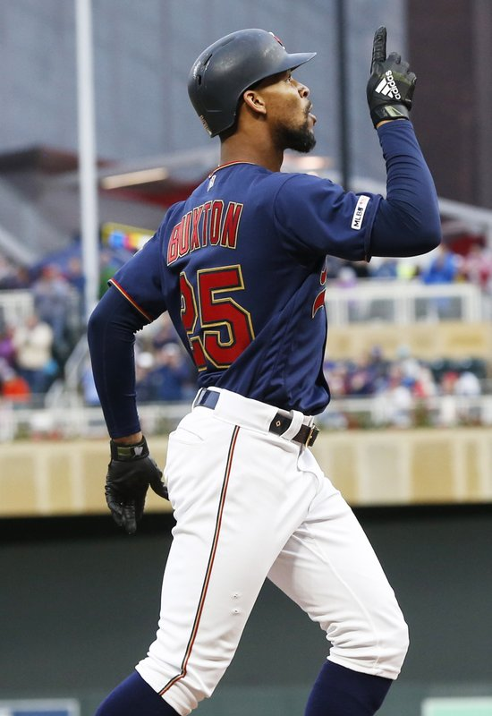 Minnesota Twins' Byron Buxton celebrates his three-run home run off Milwaukee Brewers' Gio Gonzalez in the second inning of a baseball game Monday, May 27, 2019, in Minneapolis. (AP Photo/Jim Mone)