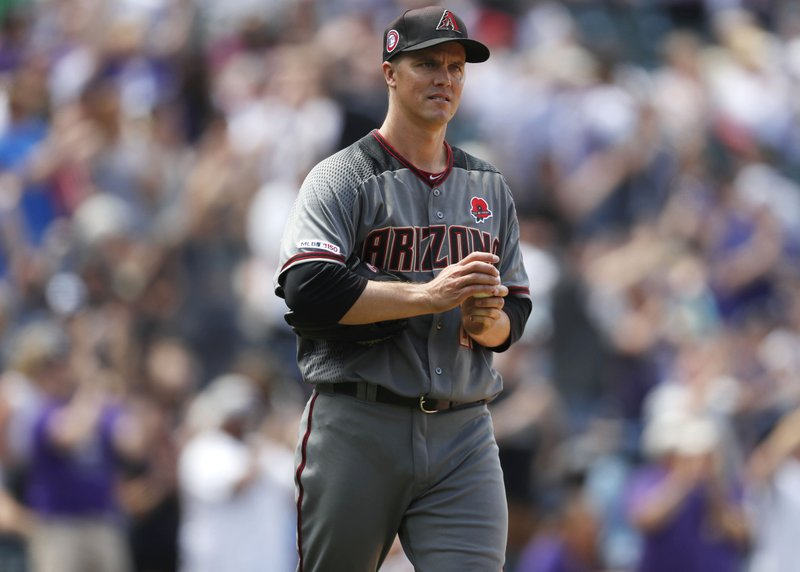 Arizona Diamondbacks starting pitcher Zack Greinke reacts after giving up a solo home run to Colorado Rockies' David Dahl in the fourth inning of a baseball game Monday, May 27, 2019, in Denver. (AP Photo/David Zalubowski)