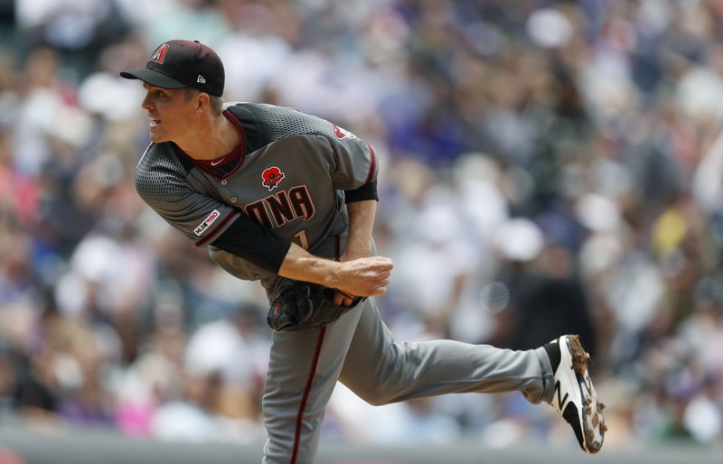 Arizona Diamondbacks starting pitcher Zack Greinke works against the Colorado Rockies in the first inning of a baseball game Monday, May 27, 2019, in Denver. (AP Photo/David Zalubowski)