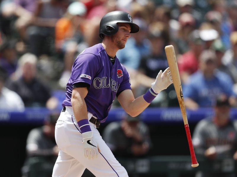 Colorado Rockies' Ryan McMahon reacts after striking out against Arizona Diamondbacks starting pitcher Zack Greinke in the second inning of a baseball game Monday, May 27, 2019, in Denver. (AP Photo/David Zalubowski)