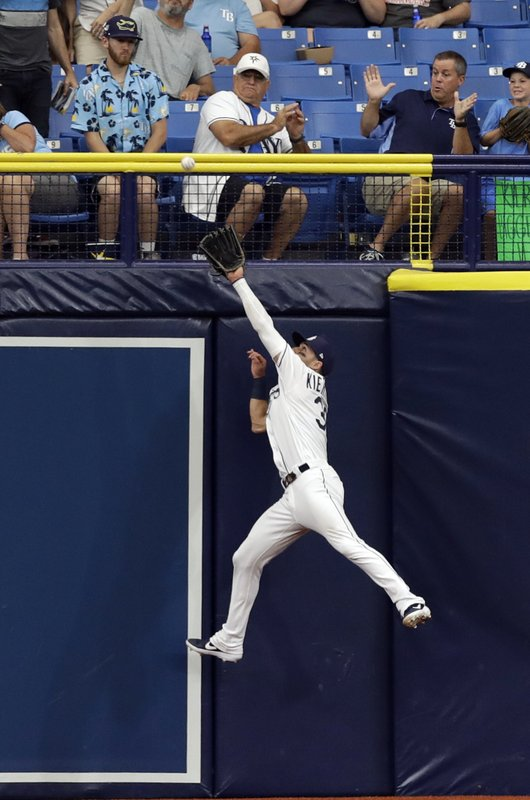 Tampa Bay Rays center fielder Kevin Kiermaier makes a leaping catch on a flyout by Toronto Blue Jays' Rowdy Tellez during the fourth inning of a baseball game Monday, May 27, 2019, in St. Petersburg, Fla. (AP Photo/Chris O'Meara)