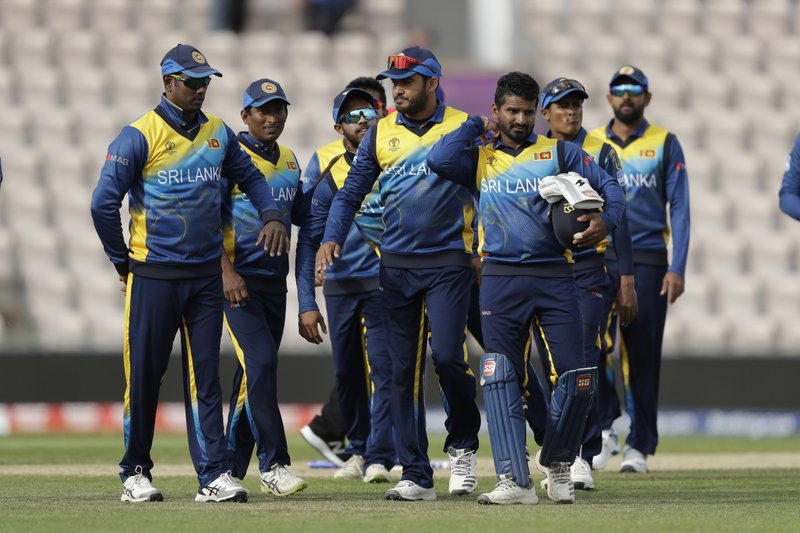 Sri Lanka walk off the field of play after they were defeated by 5 wickets in the Cricket World Cup warm-up match between Australia and Sri Lanka at the Hampshire Bowl in Southampton, England, Monday, May 27, 2019. (AP Photo/Matt Dunham)