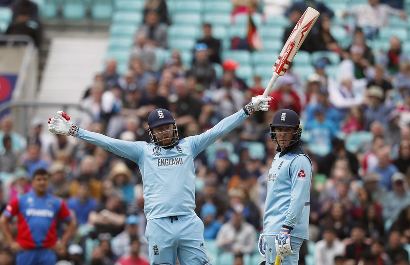 England's Jason Roy, right, and England's Jonny Bairstow celebrate during the Cricket World Cup warm up match between England and Afghanistan at the Oval in London, Monday, May 27, 2019. (AP Photo/Frank Augstein)