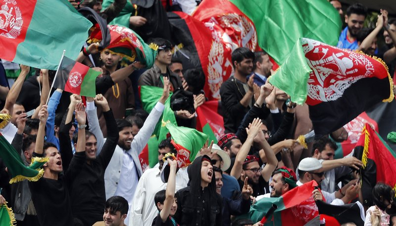 Afghanistan supporters cheer during the Cricket World Cup warm up match between England and Afghanistan at the Oval in London, Monday, May 27, 2019. (AP Photo/Frank Augstein)