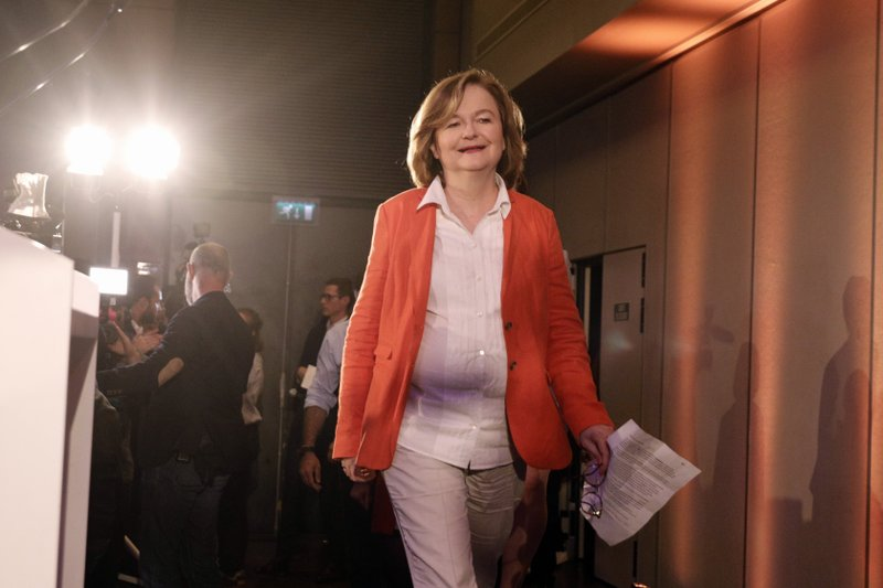 Nathalie Loiseau, center, head of French president Emmanuel Macron's party list, arrives to deliver her speech at the campaign headquarters, Sunday, May 26, 2019 in Paris. Exit polls in France indicated that Marine Le Pen's far-right National Rally party came out on top, in an astounding rebuke for French President Emmanuel Macron, who has made EU integration the heart of his presidency. (AP Photo/Kamil Zihnioglu)