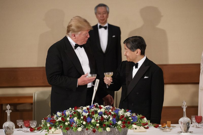 President Donald Trump toasts with Japanese Emperor Naruhito during a State Banquet at the Imperial Palace, Monday, May 27, 2019, in Tokyo. (AP Photo/Evan Vucci)
