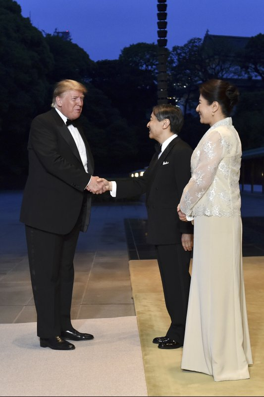 U.S. President Donald Trump, left, is greeted by Japan's Emperor Naruhito and Empress Masako upon arrival for a state banquet at the Imperial Palace in Tokyo Monday, May 27, 2019. (Kazuhiro Nogi/Pool Photo via AP)