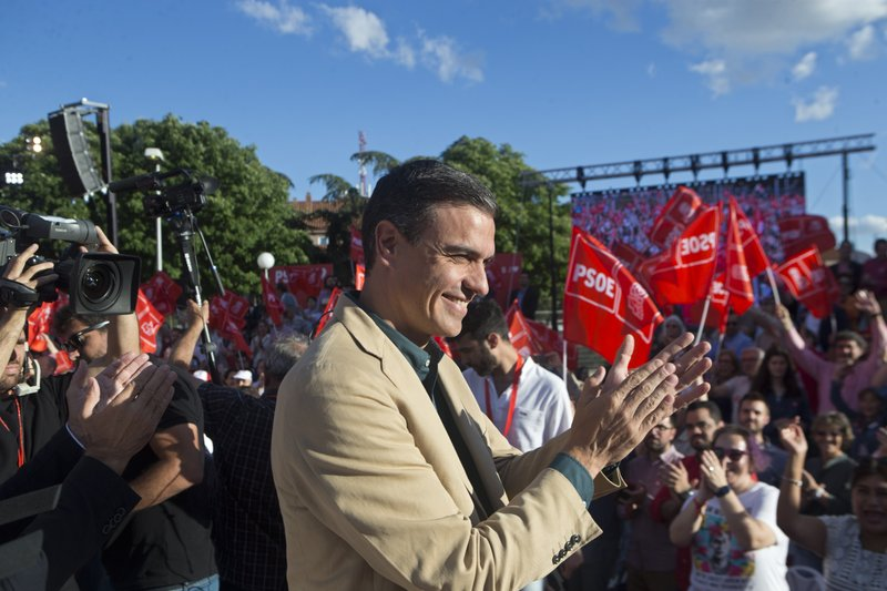 Spain's caretaker Prime Minister Pedro Sanchez applauds party supporters during the campaign for the European and municipal elections in Madrid, Spain, Friday, May 24, 2019. European Elections take place in each EU nation between May 23-26 and in Spain on May 26. (AP Photo/Paul White)