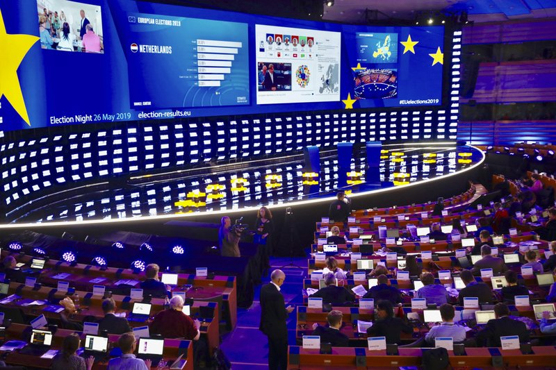 Ongoing projections of results are projected on a large screen in the press room at the European Parliament in Brussels, Sunday, May 26, 2019. From Germany and France to Cyprus and Estonia, voters from 21 nations went to the polls Sunday in the final day of a crucial European Parliament election that could see major gains by the far-right, nationalist and populist movements that are on the rise across much of the continent. (AP Photo/Olivier Matthys)