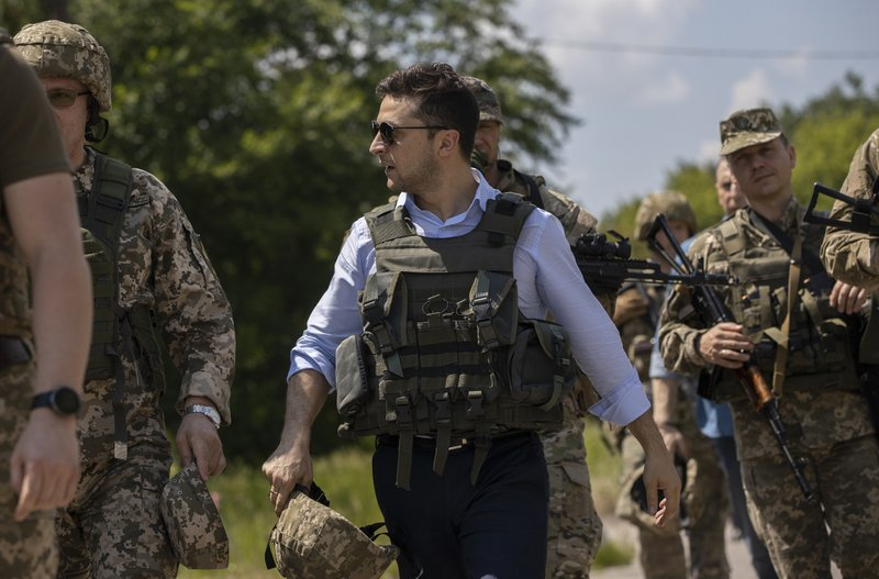 Ukrainian President Volodymyr Zelenskiy visits the war-hit Luhansk region, eastern Ukraine, Monday, May 27, 2019. (Ukrainian Presidential Press Office via AP)