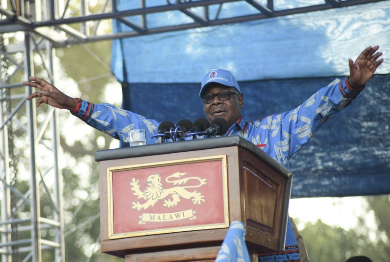 Malawian President Peter Mutharika addresses his party's Democratic Progressive Party (DPP) final election rally in Blantyre, Malawi Saturday, May 18, 2019. Corruption and the need for economic growth are the main campaign issues as Malawi goes to the polls on Tuesday for a presidential election that pits the incumbent 78-year-old president Peter Mutharika of the ruling Democratic Progressive Party against his own vice president, 46-year-old Saulos Chilima as well as the main opposition party leader Lazarus Chakwera, 64. (AP Photo/Thoko Chikondi)