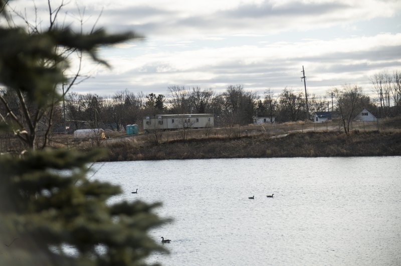 This photo taken Jan. 10, 2019, shows the former Velsicol Plant across the Pine River, in St. Louis, Mich.  Cleanup work has resumed at a former chemical plant in central Michigan that's become one of the country's costliest Superfund sites. Environmental Protection Agency official, Thomas Alcamo, told MLive.com that it could take another seven years to finish cleaning up the Velsicol Chemical plant site. (Kaytie Boomer/Saginaw News via AP)