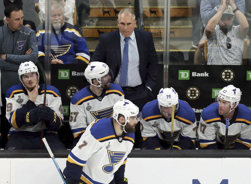St. Louis Blues head coach Craig Berube leads his team behind the bench during the second period in Game 1 of the NHL hockey Stanley Cup Final against the Boston Bruins, Monday, May 27, 2019, in Boston. (AP Photo/Charles Krupa)