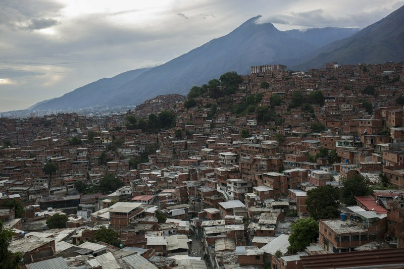 Cinderblock homes fill the hills of the Petare slum in Caracas, Venezuela, Saturday, May 25, 2019. Petare, one of Latin America's largest and most feared slums, is home to for-hire hoodlums called the Crazy Boys, who say their group now carries out roughly five kidnappings a year, down considerably from years past. (AP Photo/Rodrigo Abd)