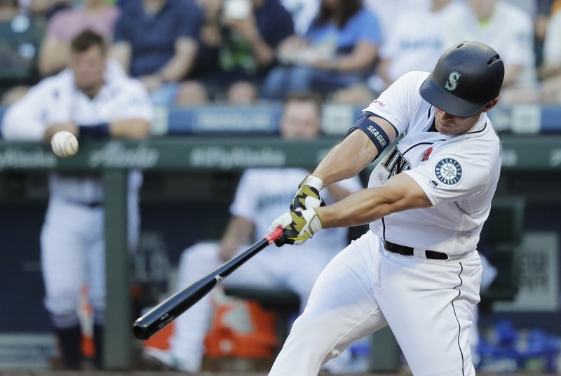 Seattle Mariners' Kyle Seager hits an RBI single to score Mallex Smith during the third inning of a baseball game against the Texas Rangers, Monday, May 27, 2019, in Seattle. (AP Photo/Ted S. Warren)
