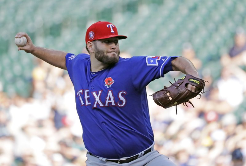 Texas Rangers starting pitcher Lance Lynn throws against the Seattle Mariners during the first inning of a baseball game, Monday, May 27, 2019, in Seattle. (AP Photo/Ted S. Warren)