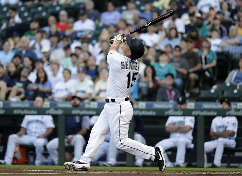 Seattle Mariners' Kyle Seager pops out during the first inning of a baseball game against the Texas Rangers, Monday, May 27, 2019, in Seattle. (AP Photo/Ted S. Warren)