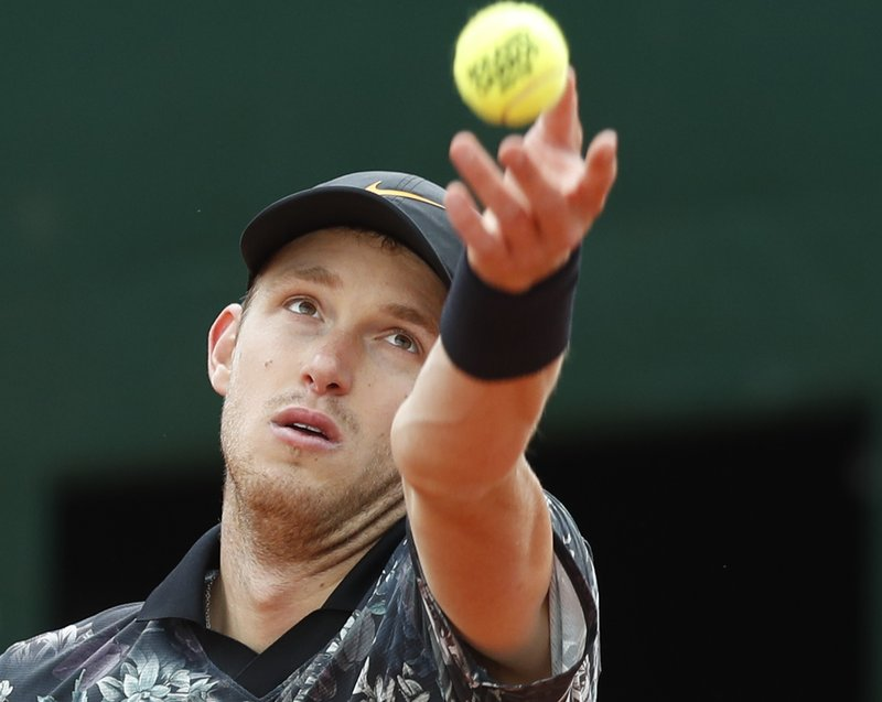 Chile's Nicolas Jarry serves against Argentina's Juan Martin del Potro during their first round match of the French Open tennis tournament at the Roland Garros stadium in Paris, Tuesday, May 28, 2019. (AP Photo/Pavel Golovkin)