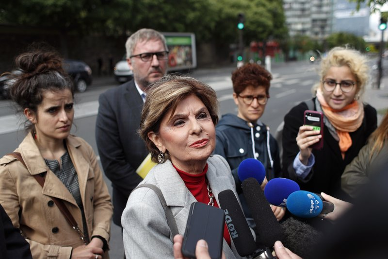 American lawyer Gloria Allred, center, gives a press conference, in Paris, Tuesday, May 28, 2019. The lawyer for a woman who filed a rape complaint in Paris against Chris Brown says the American rap artist