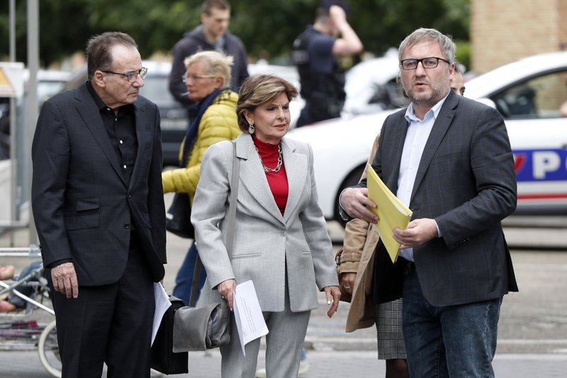 American lawyer Gloria Allred, center, and French lawyer, Jean Marc Describes, right, arrive to give a press conference, in Paris, Tuesday, May 28, 2019. The lawyer for a woman who filed a rape complaint in Paris against Chris Brown says the American rap artist