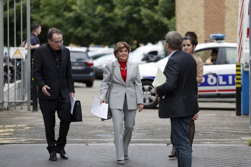 American lawyer Gloria Allred, center, arrives to give a press conference, in Paris, Tuesday, May 28, 2019. The lawyer for a woman who filed a rape complaint in Paris against Chris Brown says the American rap artist