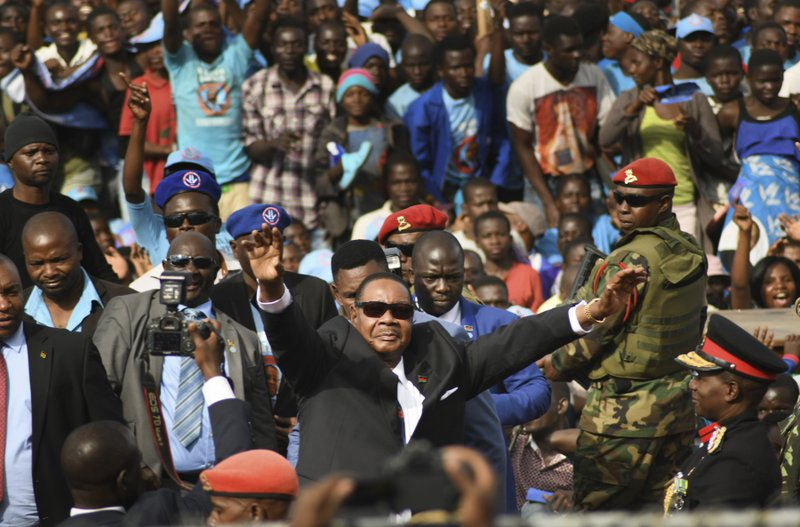Newly elected Malawi President Peter Mutharika of The Democratic Progressive Party DPP arrives for the swearing in ceremony at Kamuzu Stadium in Blantyre, Malawi, Tuesday May 28, 2019. Mutharika has called for unity after being sworn in for a second five-year term after an election in which opposition parties alleged irregularities. (AP Photo/Thoko Chilondi)