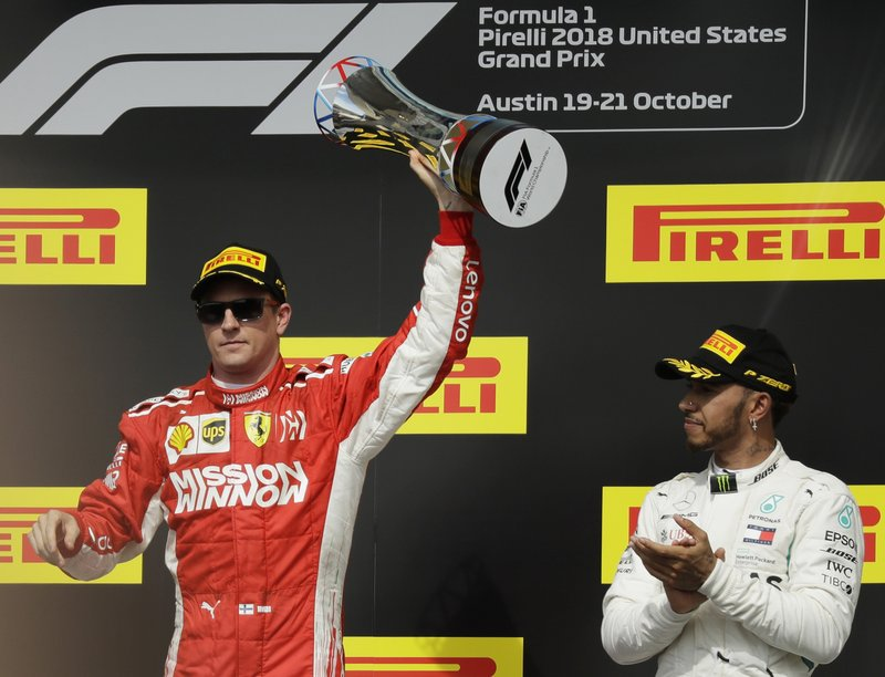 "FILE - In this Oct. 21, 2018, file photo, Ferrari driver Kimi Raikkonen, of Finland, holds the trophy after winning the Formula One U.S. Grand Prix auto race at the Circuit of the Americas, as third-placed Mercedes driver Lewis Hamilton, right, of Britain, looks on, in Austin, Texas. Formula One expects to race the U.S. Grand Prix at the Circuit of the Americas for ""many years to come,"" a series official said Tuesday, May 28, 2019, despite the track's failed effort to secure $25 million in Texas public money it was denied in 2018. Sean Bratches, F1's managing director of commercial operations, suggested the series remains confident in the Texas race's' financial security. (AP Photo/Eric Gay, File)"