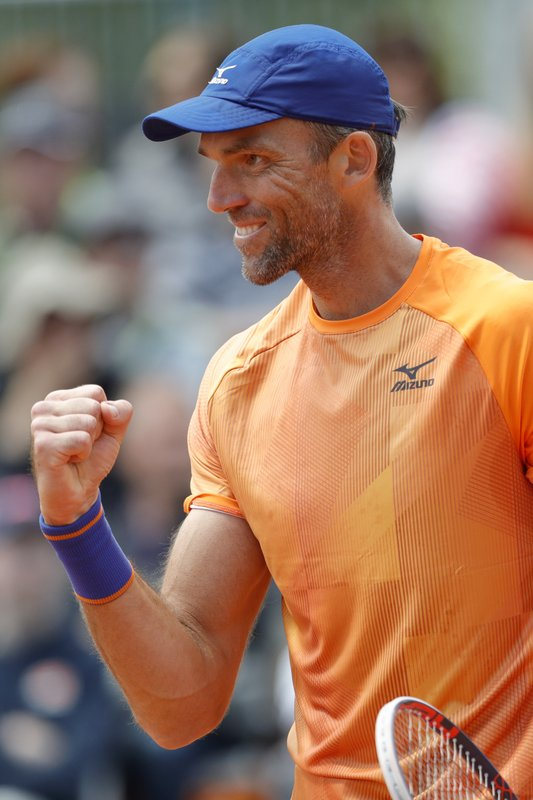 Croatia's Ivo Karlovic clenches his fist after scoring a point against Spain's Feliciano Lopez during their first round match of the French Open tennis tournament at the Roland Garros stadium in Paris, Tuesday, May 28, 2019. When 40-year-old Karlovic and 37-year-old Lopez played each other at the French Open on Tuesday, it marked a record for combined age between opponents at Roland Garros in the Open Era. (AP Photo/Pavel Golovkin)