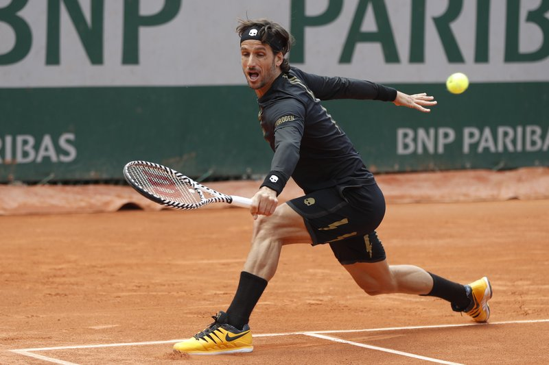 Spain's Feliciano Lopez plays a shot against Croatia's Ivo Karlovic during their first round match of the French Open tennis tournament at the Roland Garros stadium in Paris, Tuesday, May 28, 2019. When 40-year-old Karlovic and 37-year-old Lopez played each other at the French Open on Tuesday, it marked a record for combined age between opponents at Roland Garros in the Open Era. (AP Photo/Pavel Golovkin)