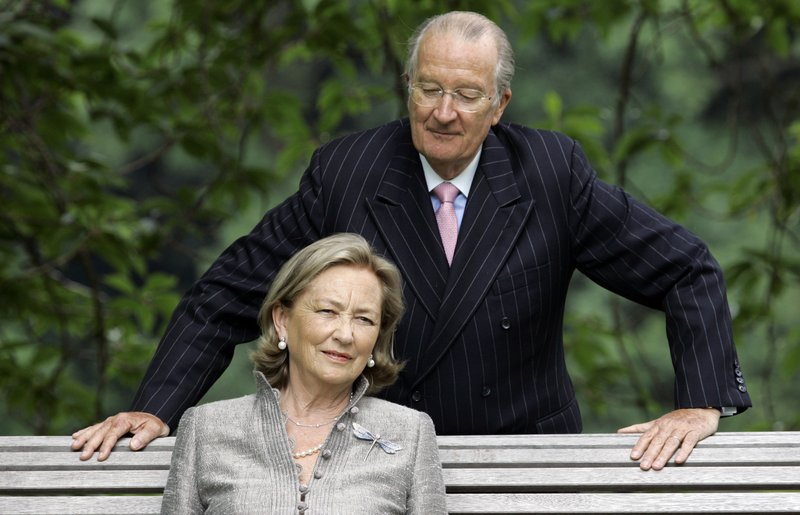 FILE - In this Tuesday, July 17, 2008 file photo, Belgium's Queen Paola and King Albert II pose for photographers at the Royal Palace in Laeken, Belgium. A decades-old royal paternity scandal is setting Belgium abuzz again. Lawyers said Tuesday, May 28, 2019 that Belgium's former King Albert II has finally agreed to a DNA test, demanded by Boel who claims to be his out of wedlock daughter. (AP Photo/Virginia Mayo, File)
