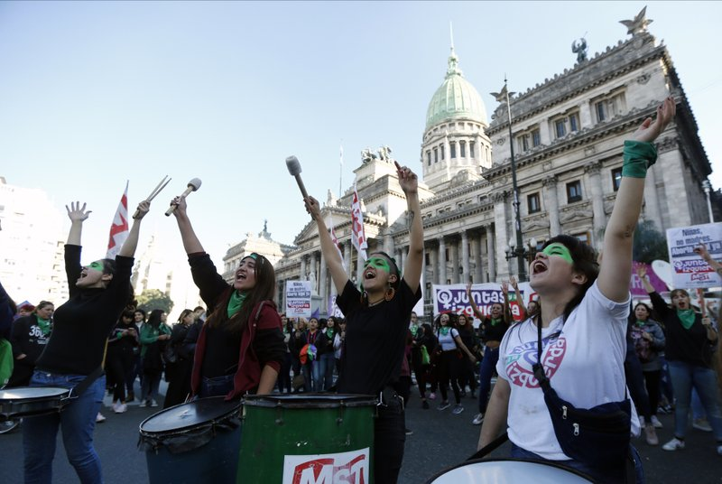 Women gather for demonstration outside the Congress in favor of legalizing abortion, in Buenos Aires, Argentina, Tuesday, May 28, 2019. Activists are launching a renewed effort to legalize elective abortions in the homeland of Pope Francis after narrowly falling short last year. (AP Photo/Marcos Brindicci)