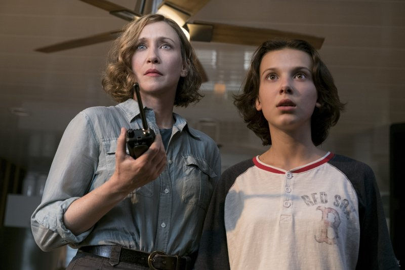 This image released by Warner Bros. Pictures shows Vera Farmiga, left, and Millie Bobby Brown in a scene from