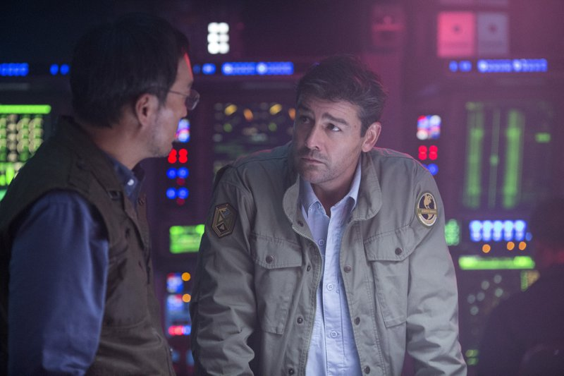 This image released by Warner Bros. Pictures shows Ken Watanabe, left, and Kyle Chandler in a scene from