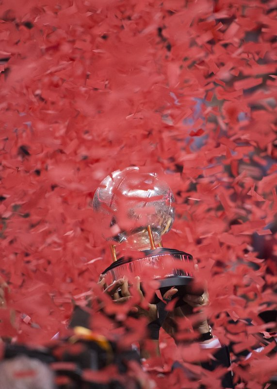 Toronto Raptors hoist the NBA basketball Eastern Conference trophy after defeating the Milwaukee Bucks 100-94 in Game 6 of the conference finals Saturday, May 25, 2019, in Toronto. (Nathan Denette/The Canadian Press via AP)