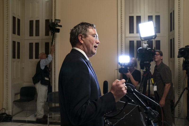 Rep. Thomas Massie, R-Ky., speaks to reporters at the Capitol after he blocked a unanimous consent vote on a long-awaited $19 billion disaster aid bill in the chamber on Tuesday, May 28, 2019. (AP Photo/J. Scott Applewhite)