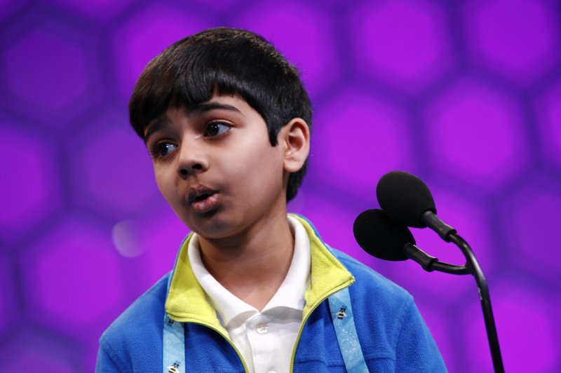Akash Vukoti, 9, of San Angelo, Texas, reacts after correctly spelling a word in the second round of the Scripps National Spelling Bee, Tuesday, May 28, 2019, in Oxon Hill, Md. (AP Photo/Patrick Semansky)