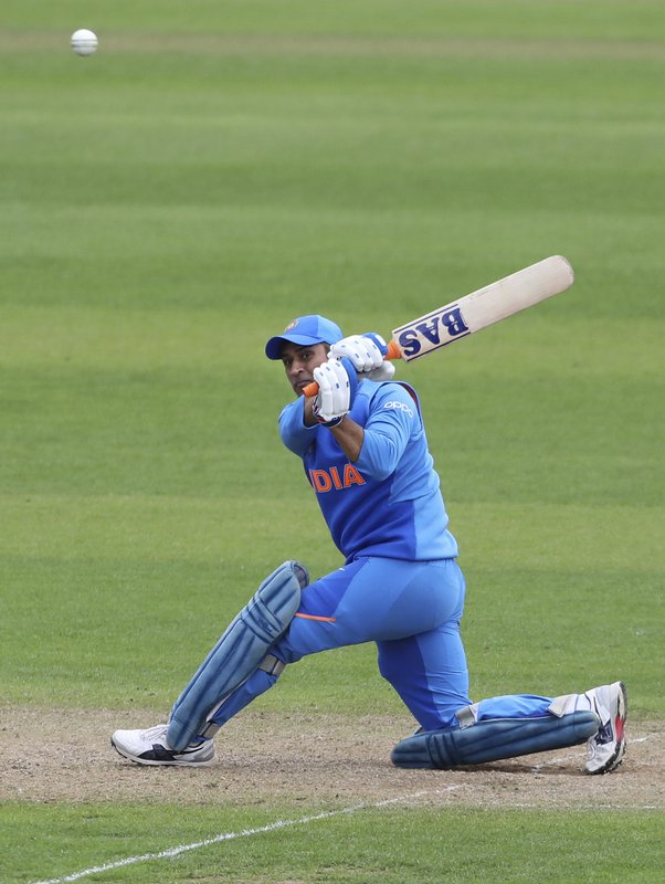India's MS Dhoni plays a shot during the Cricket World Cup warm up match between Bangladesh and India at Sophia Gardens in Cardiff, Wales, Tuesday, May 28, 2019. (AP Photo/Aijaz Rahi)