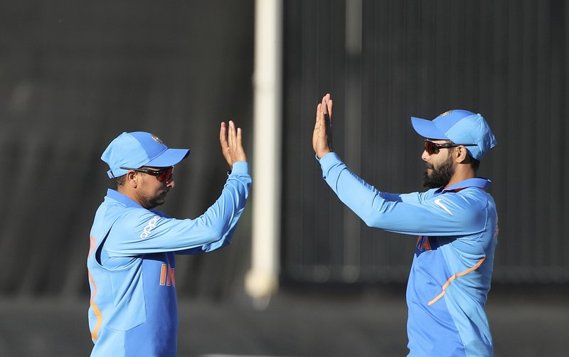 India's Kuldeep Yadav, left, celebrates with teammate Ravindra Jadeja after taking the catch to dismiss Bangladesh's Mohammad Saifuddin during the Cricket World Cup warm up match between Bangladesh and India at Sophia Gardens in Cardiff, Wales, Tuesday, May 28, 2019. (AP Photo/Aijaz Rahi)