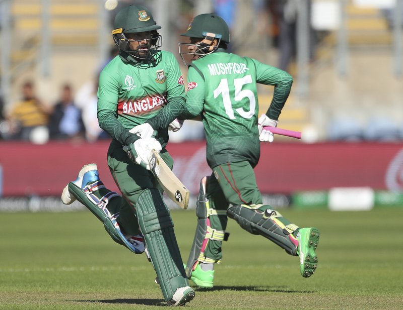 Bangladesh's Liton Das, left, and Mushfiqur Rahim run between the wickets to score during the Cricket World Cup warm up match between Bangladesh and India at Sophia Gardens in Cardiff, Wales, Tuesday, May 28, 2019. (AP Photo/Aijaz Rahi)